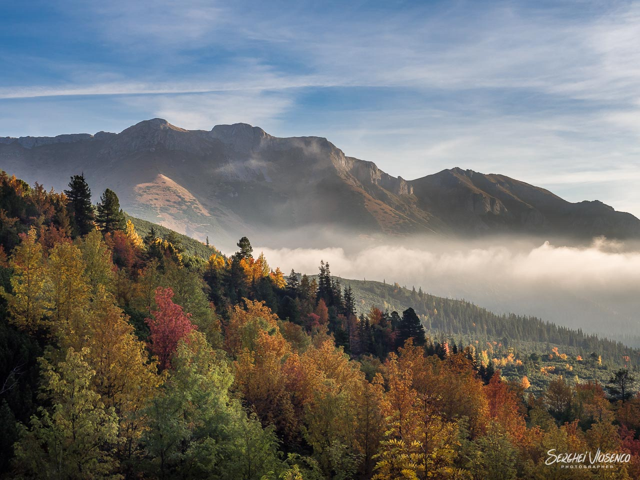 View of the autumn-colored Green Lake Valley in the High Tatras, captured during sunrise.