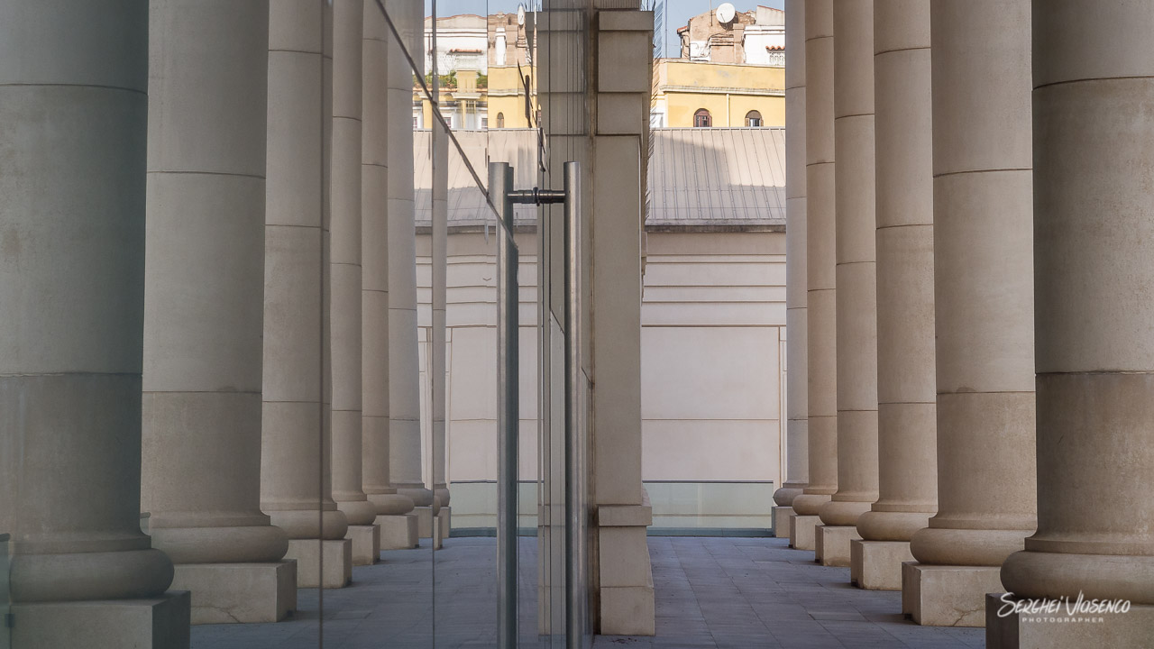 Reflection of pillars of the building of the National Theater of Catalonia